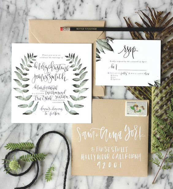 a pretty botanical print wedding invitation suite with kraft paper envelopes and leaf prints on invites is amazing