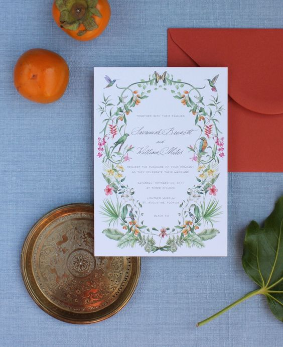 a pretty bright floral wedidng invitation with bird prints and leaf prints is a stylish idea for a colorful summer wedding