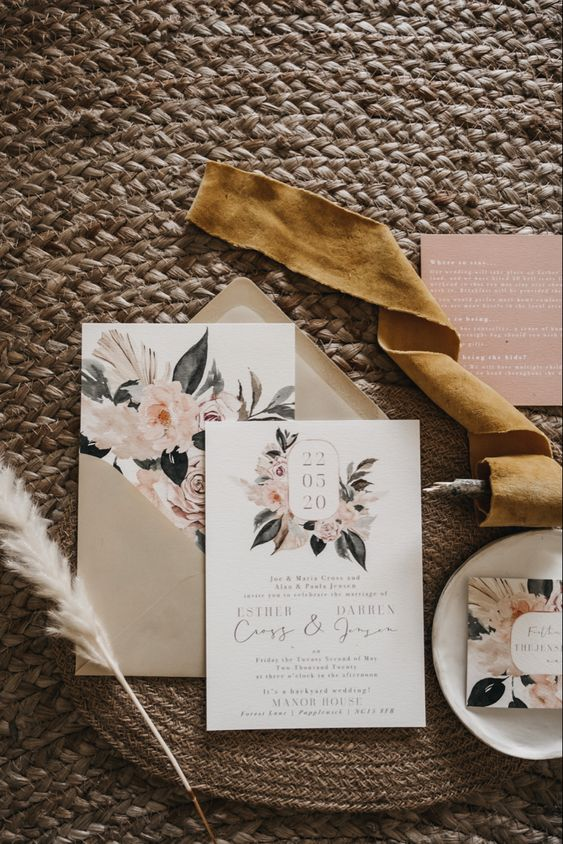 a pretty neutral and pastel floral print wedding invitation suite with elegant calligraphy for a subtle spring or summer wedding