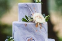 a purple marble wedding cake with gold leaf, greenery and white blooms looks chic, bold and elegant