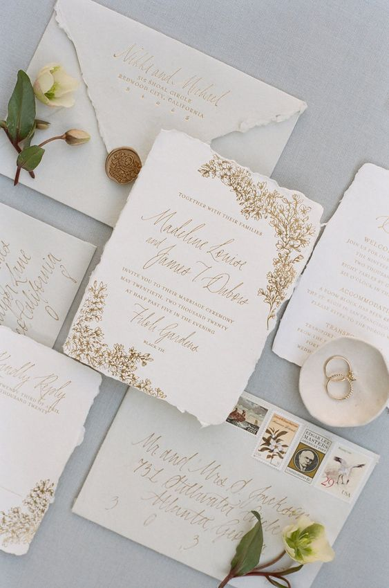 a refined and delicate botanical wedding invitation suite with gold flower prints is a gorgeous idea for a sophisticated wedding