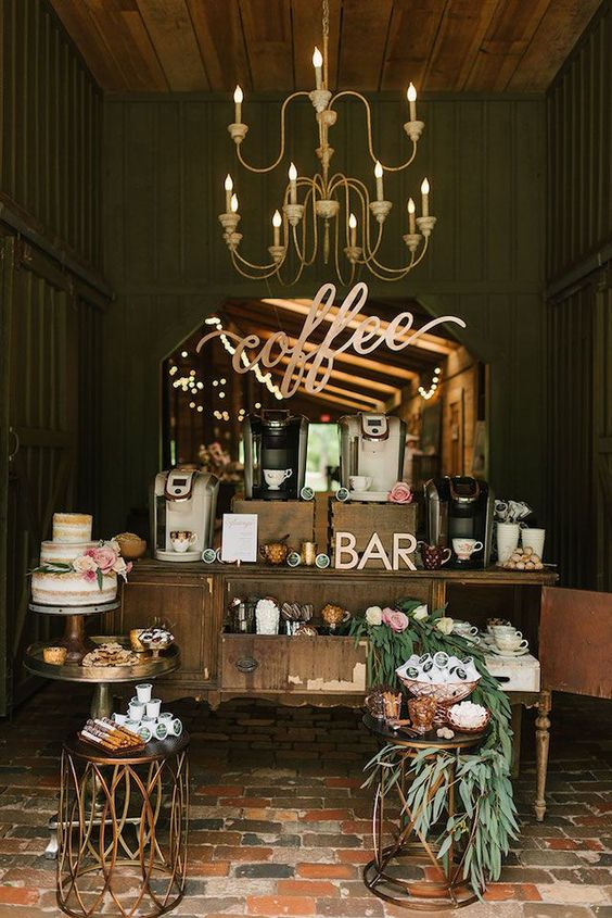 a refined vintage-inspired coffee bar with blooms, greenery, calligraphy, a naked wedding cake and lots of coffee machines