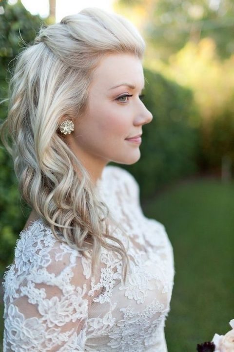 a romantic wedding half updo with a braided top and waves is a chic idea