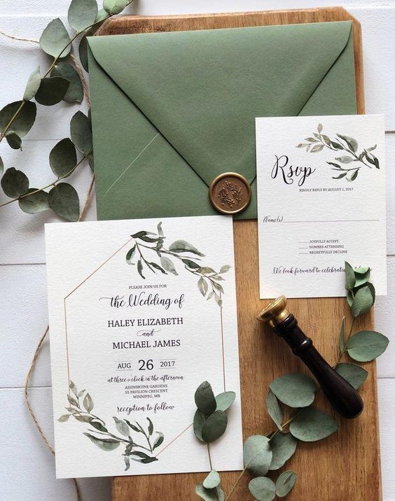 a rustic botanical wedding stationary suite with a green envelope and pretty botanical printed invites is amazing for spring