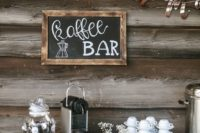 a rustic coffee bar with a chalkboard sign, crates, mugs, sweets and cream is a cute and cozy idea