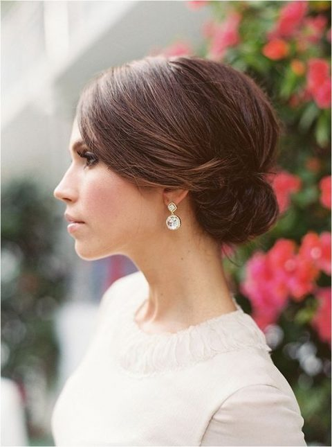 a sleek top and a small side low bun for a timelessly elegant look is suitable for medium and even short hair