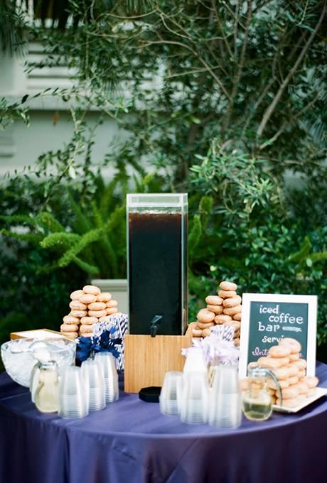 a small iced coffee bar with a sheer tank, donuts, cups and signs is what you need for a summer wedding