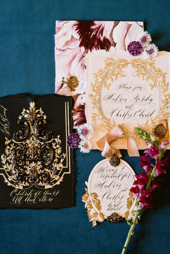 a sophisticated floral and gold patterns wedding invitation suite with a raw edge and laser cut is fantastic and gorgeous