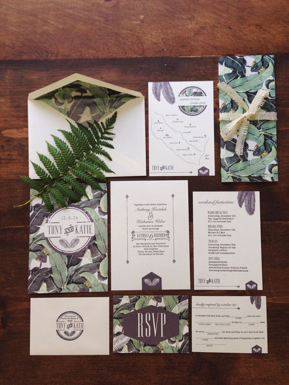 a stylish and chic tropical wedding invitation suite with banana leaf printing is a lovely idea for a modern or retro tropical wedding