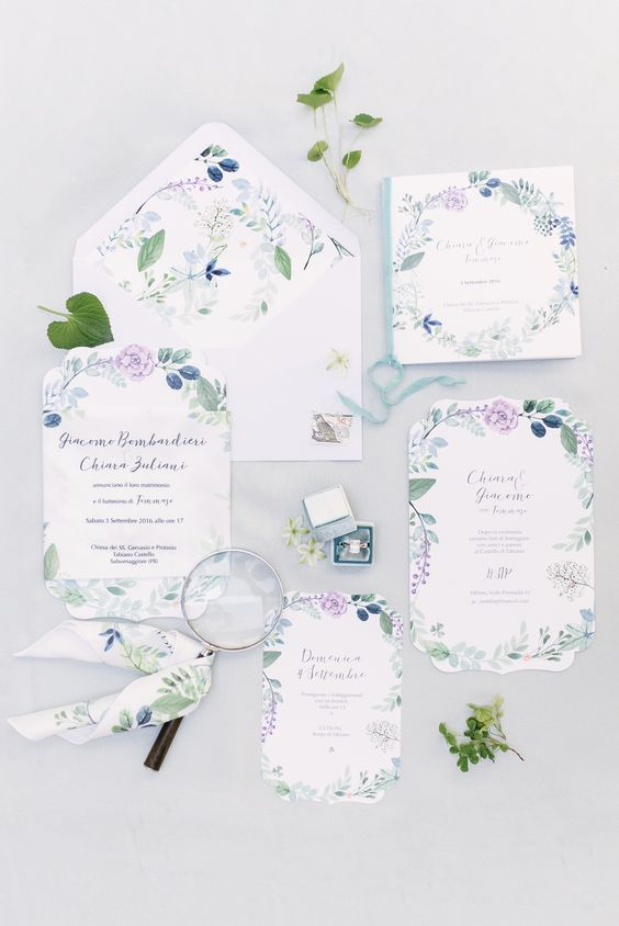 a subtle wedding invitation suite with blue and green botanical prints is a lovely idea for a spring wedding