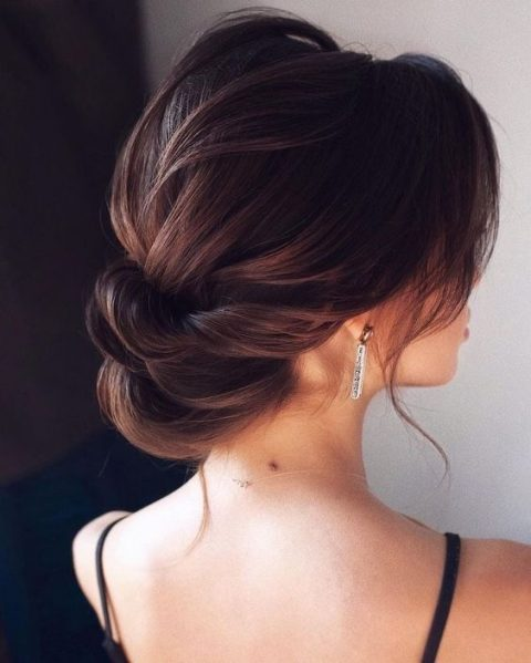 a super elegant low twisted updo with a bump and some locks down is a gorgeous idea for a refined bride