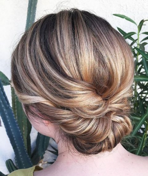 a twisted low updo with a sleek bump is an elegant and chic hairstyle for a bride or bridesmaid