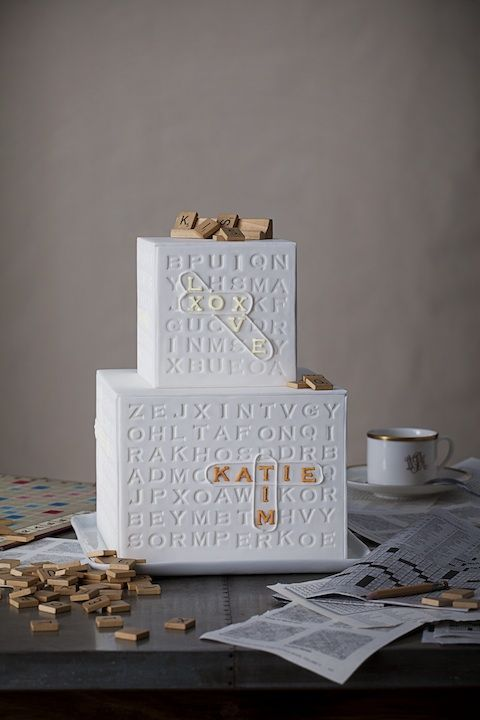 a whimsy white square wedding cake inspired by scrabble games is a fun and quirky idea for a modern wedding