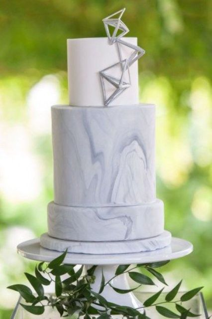 a white and grey marble wedding cake with silver geometric detailing is a lovely idea for a modern wedding