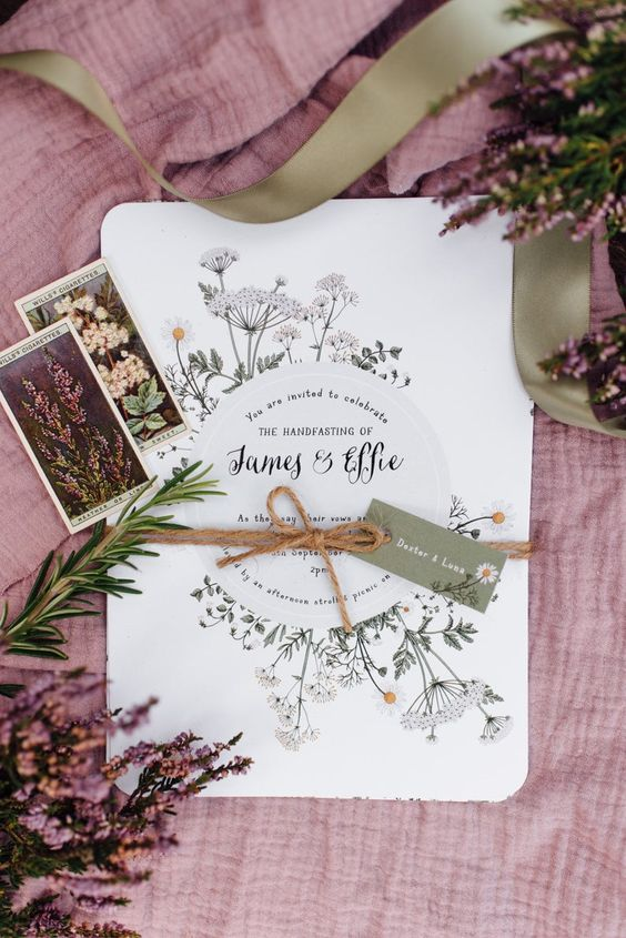 a wonderful summer meadow wedding invitation with twine and a tag is a stylish idea for a summer or spring to summer wedding