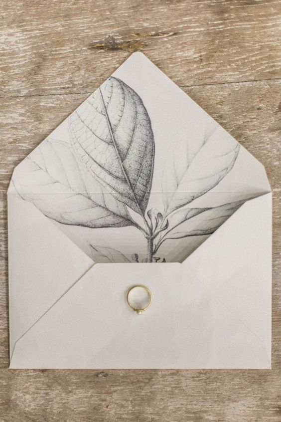 an elegant neutral envelope with grey leaf printing on the lining is a great idea for a classic or very elegant wedding