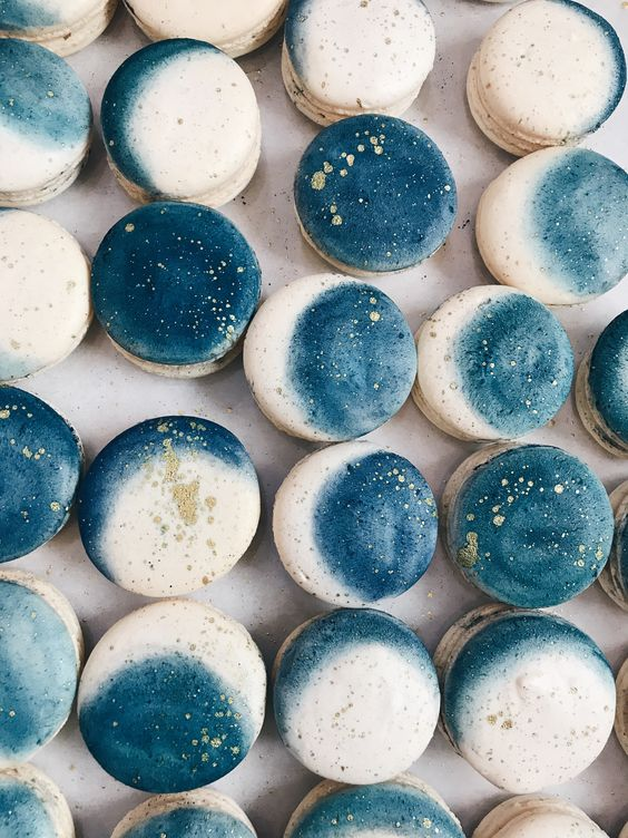 blue and neutral moon phase cookies with gold leaf on top are chic and cool desserts