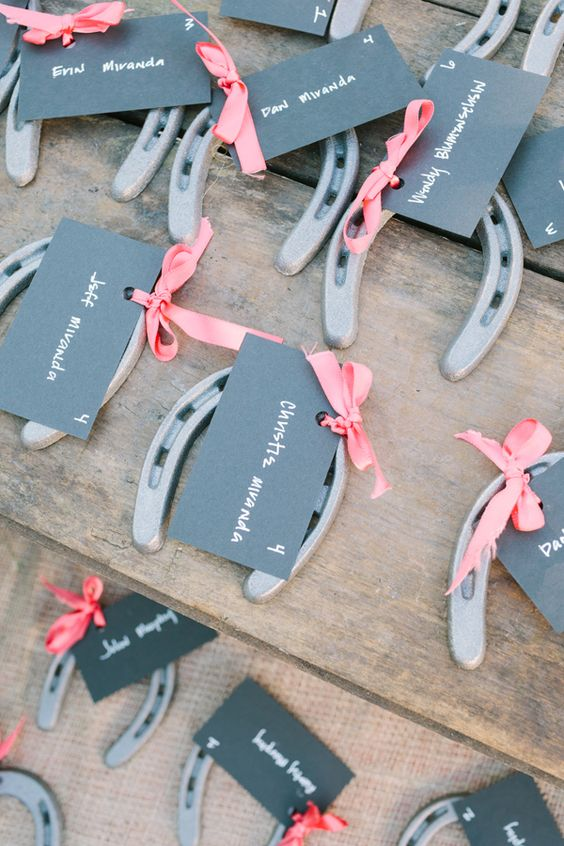 horseshoes with chalkboard tags can double as wedding favors and seating cards at the same time