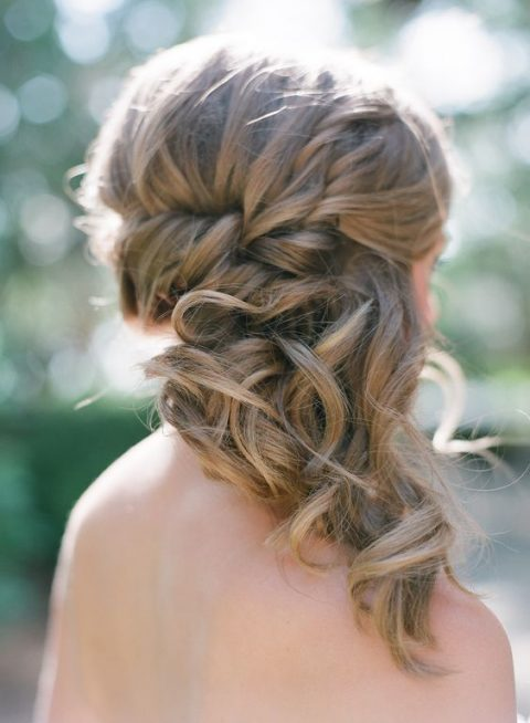 wavy and braided half updo with a bump is a stylish and chic idea for a wedding