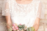 pink short hair with a fringe and pink blooms on top for accessorizing this romantic lace wedding dress