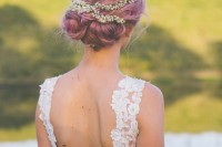 pink hair in a twisted updo topped with fresh blooms is a refined and chic idea for a romantic bridal look