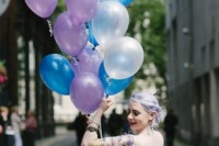 lilac hair in an updo and tattoos shown off for a bold and very personalized bridal look