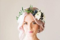 light pink hair in a wavy updo with a neutral floral crown with greenery for a relaxed boho spring or summer look