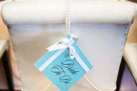 mark the bride's-to-be chair with a tiffany blue sign, a bow and pearl strands