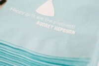printed tiffany blue napkins with Audrey Hepburn quotes is a pretty and fun idea