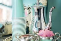a chic vintage tray with gorgeous silver bowls, a coffee pot, tiffany blue plastic cups and napkins
