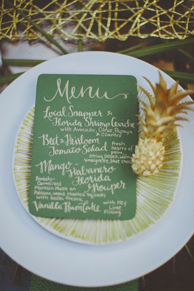 a green and gold menu plus a little gilded pineapple for a tropical bridal shower