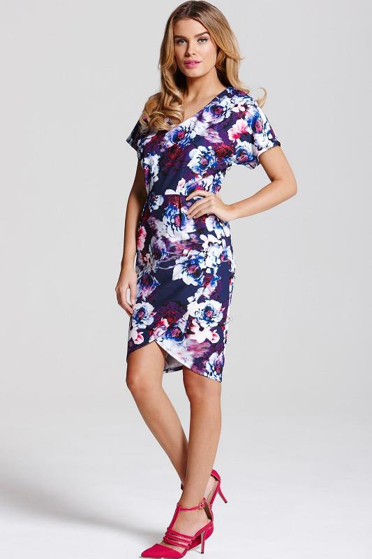 a navy floral print sheath knee dress with short sleeves, a V neckline and pink strappy shoes