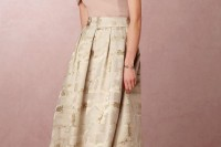 a blush off the shoulder top and an elegant neutral maxi skirt with prints make up a catchy and chic look