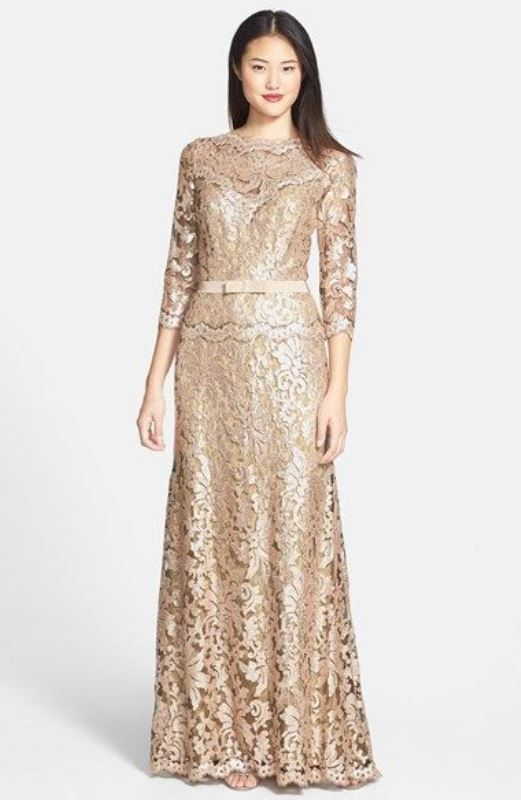 a shiny nude lace sheath maxi dress with a high neckline and short sleeves plus a belt