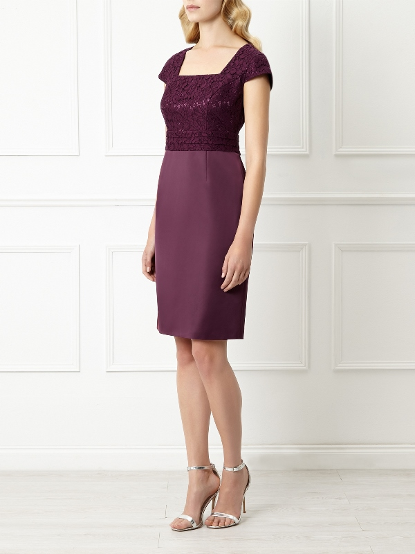 a plum-colored knee sheath dress with a lace bodice, short sleeves and a plain skirt plus silver shoes to enliven the ensemble