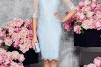 a formal light blue lace sheath knee dress with an illusion neckline and sheer sleeves plus a statement hat with a bow