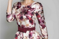 a bright floral A-line dress with a high neckline, short sleeves and a hat for a formal wedding