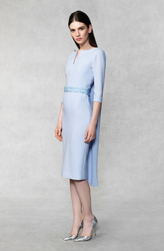a light blue sheath wedding dress with short sleeves, a deep neckline and a capelet for a more formal feel