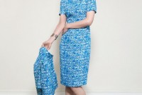 a blue sheath printed knee dress with a high neckline and short sleeves, a cropped jacket that matches and nude shoes for a retro look