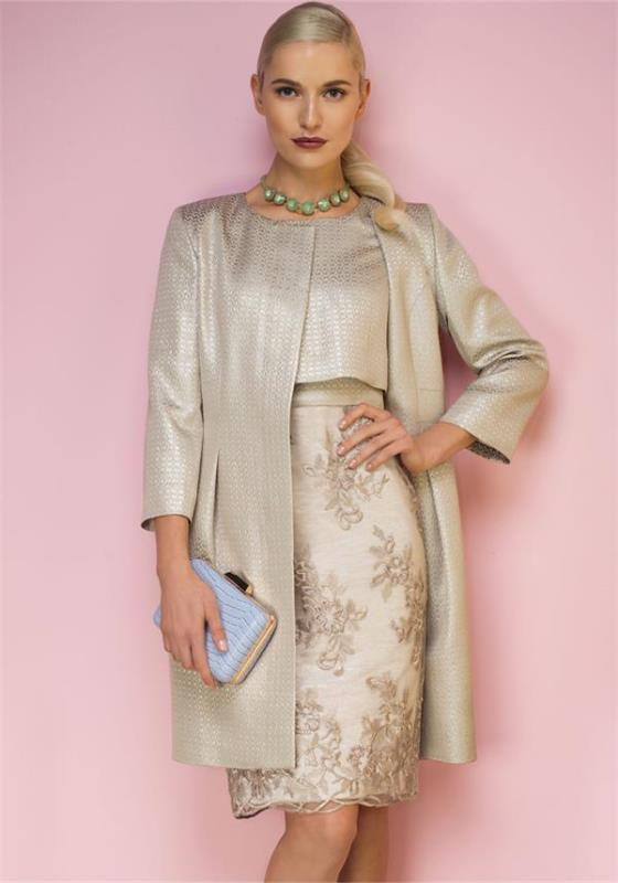 a floral pencil knee skirt, a shiny silver crop top and a matching long jacket, a statement necklace and a blue clutch
