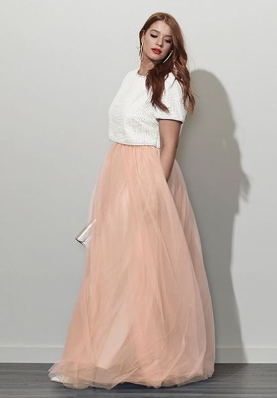 a whimsy outfit with a shiny white crop top and a peachy full tulle maxi skirt plus a silver clutch