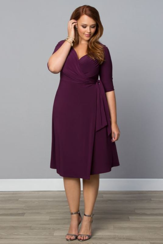 a plum colored knee wrap dress with a draped bodice and short sleeves is a very comfortable option