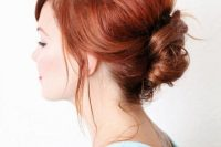 a messy French twist updo with a messy volume on top with locks down looks sepctacular and cool on red hair