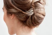 a chic French twist updo with a side bang and a volume on top looks a bit messy and very chic