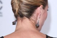a sleek and super tight French twist updo on medium hair with balayage is a modern and fresh idea