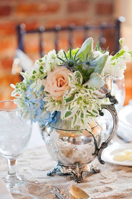 a vintage silver teapot with blue, pink and white blooms, thistles and greenery for a chic centerpiece