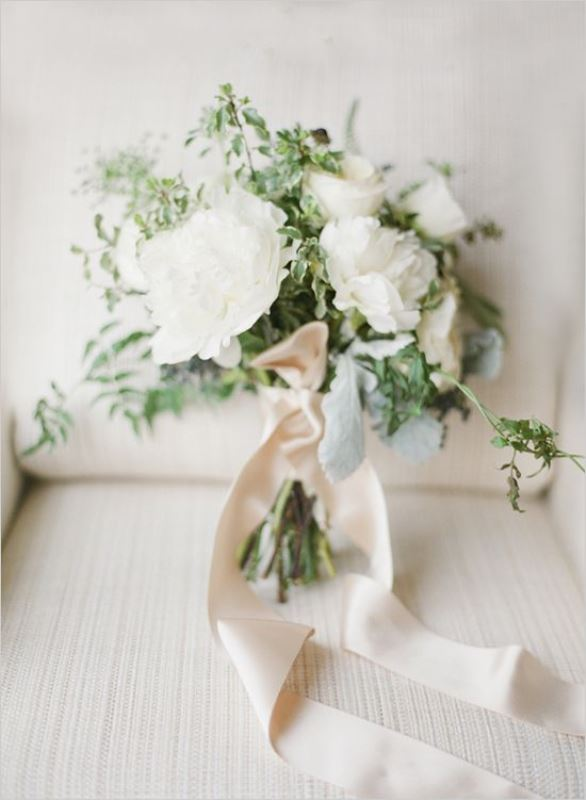 a white peony wedding bouquet with greenery and neutral ribbons is a classic idea of a bouquet