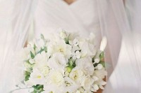 an elegant white wedding bouquet with texture and some greenery is a chic idea for any season