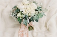 a chic white wedding bouquet with foliage and blush ribbons is a cool idea with a whimsy touch