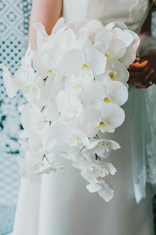 a stylish all white orchid wedding bouquet